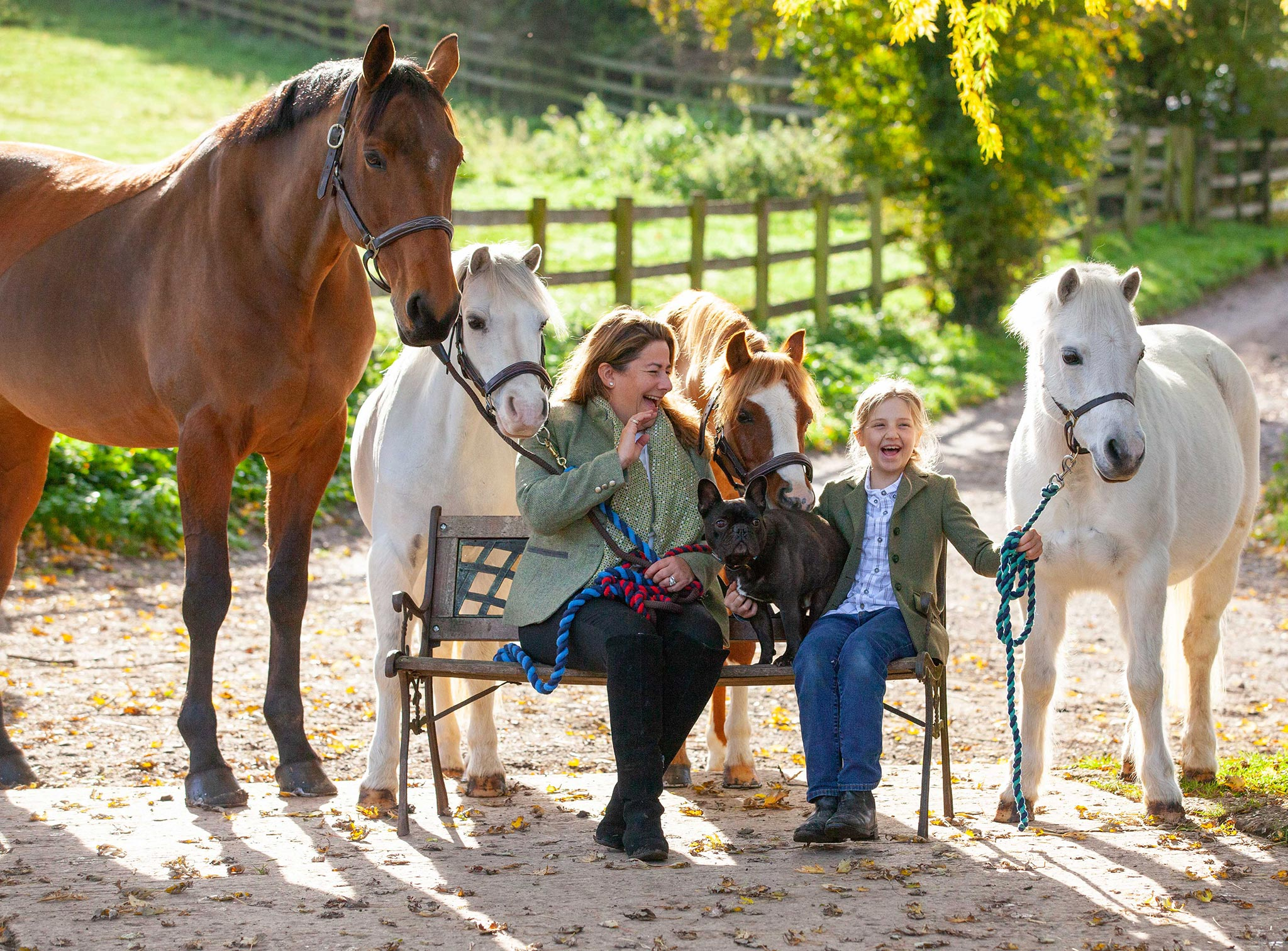 Woman and daughter with three horses photo shoot
